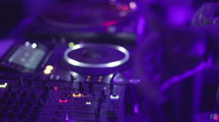 DJ standing behind turntable, entertaining crowd, music performance at concert Stock Footage