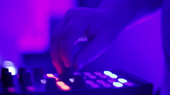 Closeup of DJ's hand turning controls on sound board, professional performance Stock Footage
