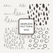 Set of vector seamless patterns with scribbles and raindrops Stock Illustration