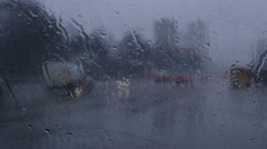 The raindrop fall on the windshield of the car. Real time capture Stock Footage