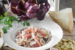 Orecchiette With Red Chicory And Speck Stock Photos