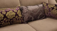 Pillows on sofa in apartment Stock Footage