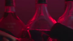 Many bottles displayed at bar counter, alcohol abuse, poor lifestyle choices Stock Footage