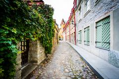 A narrow cobblestone street, in the Old Town of Tallinn, Estonia. Stock Photos
