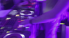 Timelapse of DJ switching controls, performing music on sound board in nightclub Stock Footage