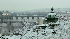 A view of Prague's bridges and the Vltava river on a snowy day. Stock Footage