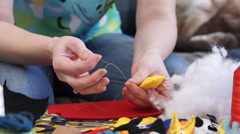The Woman's Hands Creates Bright Colored Toys of Handmade - stock footage