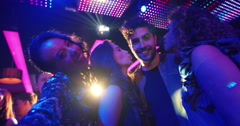Party Couple making silly faces for selfie in night club Stock Footage