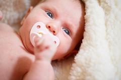 Little newborn baby girl Stock Photos