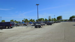 Boat trailers at a marina Stock Footage