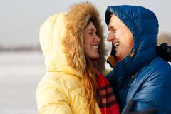 Happy Young Couple in Winter Park having fun.Family Outdoors. love kiss Stock Photos