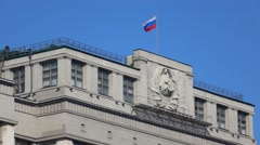 Russian flag above Russian legislative body State Duma. Moscow. 4K video Stock Footage