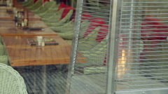 Gas heater in restaurant without people. Reflect on glass. Old Town, Prague Stock Footage