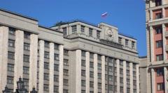 Russian flag above Russian legislative body State Duma. Moscow. 4K video - stock footage