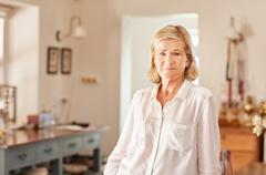 Senior woman at home with a serious facial expression Stock Photos
