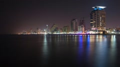 Night to day time lapse of the city of Tel Aviv with overexposed end of the clip Stock Footage