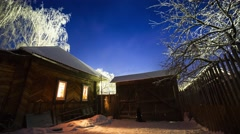 Night to day time lapse of the winter garden with wooden house - stock footage