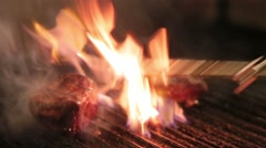 Cook roasts the meat over high heat on the grill Stock Footage
