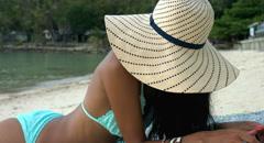 Beautiful Woman Lying on a Tropical Beach Stock Footage