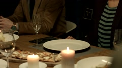 Waiter pours wine to a guest at a restaurant. Stock Footage