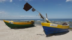 Boats on the beach in Jantar, Poland Stock Footage