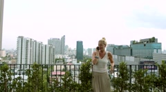 Blond Woman Making a Phone Call - stock footage