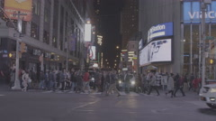 Movi tracking people walking across street in NYC Stock Footage