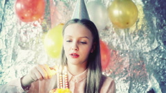 Pretty girl holding birthday cake and smiling Stock Footage