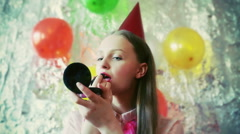 Birthday girl using lipstick to correct her makeup Stock Footage