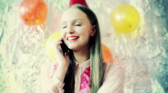 Happy birthday girl chatting on cellphone, steadycam shot Stock Footage