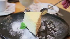 Breaking of a piece of cheesecake on a plate Stock Footage