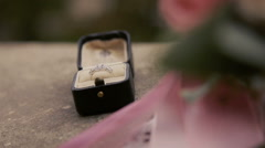 Wedding ring with diamond on the ground close up - stock footage