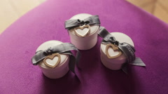 Boxes with wedding rings on purple background Stock Footage