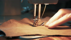 Sewing a leather material on the sewing machine, 4k Stock Footage