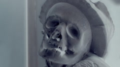 Creepy human skull in negativ - horror background, seamless loop Stock Footage