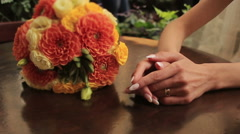 Bride holds hands with wedding bouquet close up - stock footage