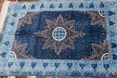 Finely woven silk carpets Stock Photos