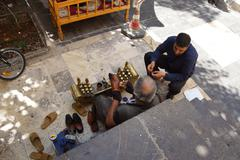 Shoe shine man works Stock Photos