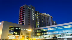 Generic Health Care Modern Hospital Exterior Building at night. 4K Time Lapse Stock Footage