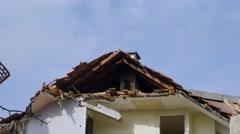 Excavator demolishing a house - stock footage