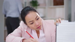 4K Architect or engineer working with construction model at her desk - stock footage