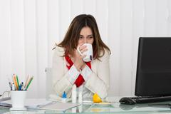Young Businesswoman Drinking Cup Of Hot Beverage In Office - stock photo