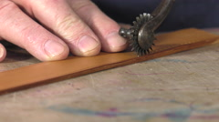 Leather goods master craftsman at work Stock Footage