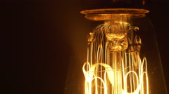 macro of an antique light bulb being turned slowly turned off 4k - stock footage