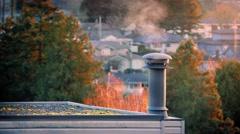 Chimney Smoking On Peaceful Evening In Suburbs Stock Footage