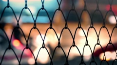 City Nightlife Through Fence Abstract Stock Footage