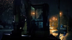 Construction Machines On City Road In Snowfall Stock Footage