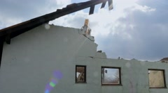 Excavator demolishing a house Stock Footage