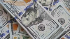 Us Dollars Bundle Closeup Rotation On The Top Of Usd Banknotes Heap. - stock footage