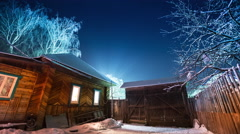 Night to day time lapse of the winter garden with wooden house Stock Footage